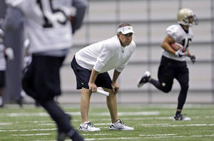 Photo - New Orleans Saints head coach Sean Payton watches drills during NFL football practice at their training facility in Metairie, La., Tuesday, June 11, 2013. (AP Photo/Gerald Herbert)