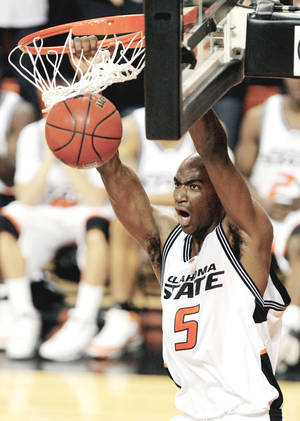 Photo - Former Oklahoma State forward Marcus Dove will play on the Thunder's summer league team.  Photo by Matt Strasen, The Oklahoman Archive