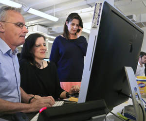 Photo - Janine Gibson, right, Guardian U.S. editor in chief, looks on as Ewan MacAskill, left, and Laura Poitras, center, part of the reporting team that won a Pulitzer Prize for The Guardian US, the British newspaper's American operation, chat online with leaker Edward Snowden, Monday April 14, 2014, in New York. The Guardian and The Washington Post won the Pulitzer Prize in public service Monday for revealing the U.S. government's sweeping surveillance efforts in a blockbuster series of stories based on National Security Agency secret documents handed over by Snowden. (AP Photo/Bebeto Matthews)