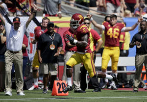 Photo - Southern California wide receiver Marqise Lee scores on an 80-yard pass play against Boston College during the first half of an NCAA college football game in Los Angeles, Saturday, Sept. 14, 2013. (AP Photo/Chris Carlson)