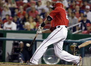 Photo - Washington Nationals' Jayson Werth (28) hits an RBI double to score the winning run during the eighth inning of a baseball game against the New York Mets at Nationals Park, Sunday, Sept. 1, 2013, in Washington. The Nationals won 6-5. (AP Photo/Alex Brandon)