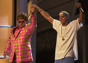 Photo -   FILE - In this Feb. 21, 2001 file photo, Elton John, left, and Eminem appear together after performing a duet near the end of the 43rd annual Grammy Awards, at the Staples Center in Los Angeles. Anti-gay sentiments have been entrenched in hip-hop for decades. Eminem, widely known for offensive lyrics toward homosexuals, has joined Jay-Z in saying people of the same-sex should be able to love one another. (AP Photo/Kevork Djansezian, File)