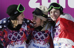 Photo - United States' Sage Kotsenburg, center, celebrates with  Norway's Staale Sandbech, left, and Canada's Mark McMorris after Kotsenburg won the men's  snowboard slopestyle final at the Rosa Khutor Extreme Park, at the 2014 Winter Olympics, Saturday, Feb. 8, 2014, in Krasnaya Polyana, Russia. Sandbech took the silver medal and McMorris took bronze. (AP Photo/Andy Wong)