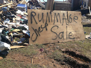 "Photo - Tom Bridges' house was destroyed in Moore on Monday, May 20. He put a sign up that said ""Rummage sale-cheap"" to get 'A laugh out of all this mess. We need that,"" the Army veteran, 68, said. The sign drew attention from passers-by.  <strong></strong>"