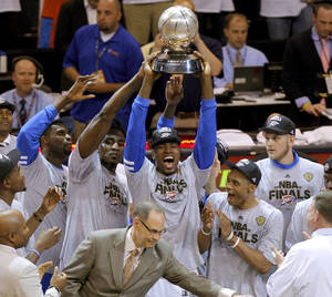 photo - Oklahoma City's Serge Ibaka holds the Western Conference trophy beside Nazr Mohammed, left,, Kendrick Perkins, Russell Westbrook, and Cole Aldrich after Game 6 of the Western Conference Finals between the Oklahoma City Thunder and the San Antonio Spurs in the NBA playoffs at the Chesapeake Energy Arena in Oklahoma City, Wednesday, June 6, 2012. Oklahoma City won 107-99. Photo by Bryan Terry, The Oklahoman