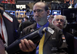 Photo - Trader Andrew Silverman, center, works on the floor of the New York Stock Exchange, Thursday, Dec. 12, 2013. Lower U.S. stock prices on Thursday set up investors for what would be their third day in a row of declines. (AP Photo/Richard Drew)