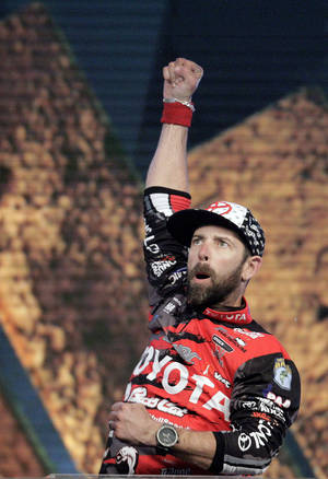Photo - Michael Iaconelli celebrates during  the first day weigh in of the Bassmaster Classic  Feb. 22, 2013. MIKE SIMONS/Tulsa World