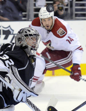 Photo -   Los Angeles Kings goalie Jonathan Quick, left, keeps his eye on the puck as Phoenix Coyotes left wing Taylor Pyatt looks on during the first period of Game 3 of the NHL hockey Stanley Cup Western Conference finals, Thursday, May 17, 2012, in Los Angeles. (AP Photo/Mark J. Terrill)