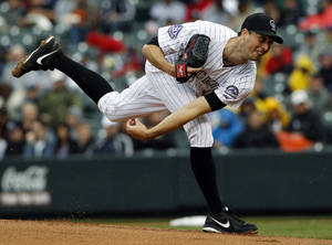 Photo - Colorado Rockies starting pitcher Jeff Francis works against the New York Yankees in the first inning of a baseball game in Denver, Thursday, May 9, 2013. (AP Photo/David Zalubowski)
