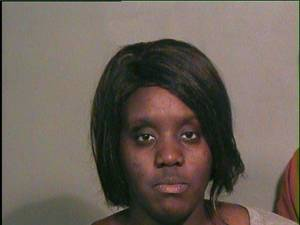 Photo - Dinesha Neal, 23, was arrested on a complaint of destruction of property on Tuesday after she admitted to smashing her neighbor's window with a hammer in the 2100 block of Kelham Avenue. PHOTO PROVIDED <strong>Courtesy</strong>