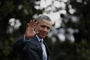 Photo - President Barack Obama waves to reporters as he walks on the South Lawn of the White House in Washington, Wednesday, Feb. 19, 2014, before boarding the Marine One helicopter to Andrews Air Force Base, Md., for his trip to Mexico. (AP Photo/Charles Dharapak)