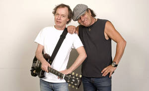 Photo -   FILE - In this Sept. 9, 2008 file photo, Angus Young, left, and Brian Johnson of AC/DC are photographed in New York. As part of the biggest and most enduring bands in the world, Young and Johnson believe that early struggles got them to where they are today. (AP Photo/Jim Cooper, file)