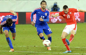 Photo - Swiss Josip Drmic , right, scores the opening goal  during a  friendly soccer match between Switzerland and Croatia at the AFG Arena in St. Gallen, Switzerland, Wednesday, March 5, 2014. (AP Photo/Keystone,Walter Bieri)