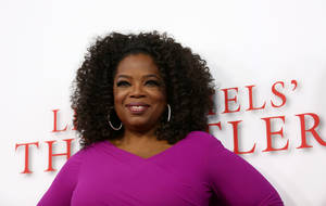 "Photo - Oprah Winfrey arrives at the Los Angeles premiere of ""Lee Daniels' The Butler"" at the Regal Cinemas L.A. Live Stadium 14 on Monday, Aug. 12, 2013. (Photo by Matt Sayles/Invision/AP)"