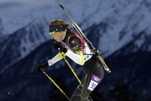 Photo - Slovakia's Anastasiya Kuzmina competes to win the gold medal in the women's biathlon 7.5k sprint, at the 2014 Winter Olympics, Sunday, Feb. 9, 2014, in Krasnaya Polyana, Russia. (AP Photo/Felipe Dana)