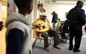 Photo - Abdulkadir Said, played traditonal Somali music as visitors walked in during the grand opening of the Somali Artifact and Cultural Museum in Minneapolis  Min., Saturday, Oct. 19, 2013. (AP Photo/The Star Tribune, Kyndell Harkness)