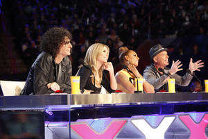 """Photo - This March 4, 2013 photo shows the judges for season eight of the talent competition series """"America's Got Talent,"""" from left, Howard Stern, Heidi Klum, Mel B, and Howie Mandel during auditions in New Orleans. NBC's """"America's Got Talent"""" is moving from New Jersey to New York City's Radio City Music Hall. New York Gov. Andrew Cuomo made the announcement Wednesday, April 3.  The eighth season of the popular talent competition will air live from the landmark theater twice a week, starting July 23. (AP Photo/NBC, Skip Bolen)"""