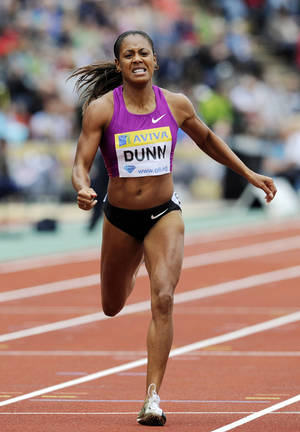 Photo -   FILE - In this Aug. 14, 2010, file photo, Debbie Dunn, of the United States, competes in the women's 400 meters during a Diamond League Athletics meeting at Crystal Palace in London. Dunn took her name off the U.S. Olympic team roster Friday, July 13, 2012, after testing positive for excessive testosterone. Dunn, who finished fourth in the 400 meters at Olympic trials, was selected for the American relay pool. She is the 2010 world indoor champion at 400 meters and would have been a likely candidate to run in the Olympic 1,600-meter relay, which the American women have won every year since 1996. (AP Photo/Tom Hevezi, File)