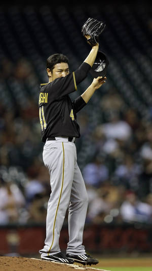 Photo -   Pittsburgh Pirates relief pitcher Hisanori Takahashi reacts after giving up a home run to Houston Astros' Brett Wallace during the seventh inning of a baseball game on Friday, Sept. 21, 2012, in Houston. (AP Photo/David J. Phillip)