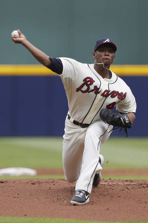 Photo - Starting Atlanta Braves pitcher Julio Teheran (49) throws a pitch in the first inning of a baseball game against the San Diego Padres at Turner Field on Sunday, Sept. 15, 2013, in Atlanta. (AP Photo/Butch Dill)