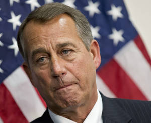 photo - FILE - This Jan. 22, 2013 file photo shows House Speaker John Boehner of Ohio talking to reporters on Capitol Hill in Washington following a long closed-door meeting on a strategy to deal with a potential debt crisis.  The House overwhelmingly passed a bill Wednesday to permit the government to borrow enough money to avoid a first avoid default for at least four months, defusing a crisis looming next month and setting the stage for a springtime debate over taxes, spending and the deficit.  (AP Photo/J. Scott Applewhite, File)