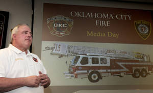 Photo -  Oklahoma City Deputy Fire Chief Marc Woodward talks with the media Friday. Photo by David McDaniel, The Oklahoman  <strong>David McDaniel -   </strong>