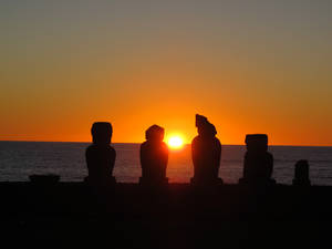 Photo -   This August 2012 photo shows the sunset behind the Ahu Vai Uri platform at Tahai on Easter Island. Tahai, within easy walking distance of the town of Hanga Roa, was restored between 1968 and 1970 and features three different platforms. (AP Photo/Karen Schwartz)