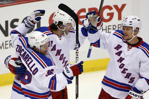 Photo - New York Rangers' Benoit Pouliot, center, celebrates his goal with Mats Zuccarello (36) and Anton Stralman (6) during the first period of an NHL hockey game against the Pittsburgh Penguins in Pittsburgh, Friday, Feb. 7, 2014. (AP Photo/Gene J. Puskar)