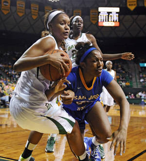 Photo - Baylor forward Nina Davis (13), left, battles San Jose State guard Rebecca Woodberry (33), right, for a loose rebound in the first half of an NCAA college basketball game, Tuesday, Dec. 3, 2013, in Waco, Texas. (AP Photo/Waco Tribune Herald, Natalie Fletcher)