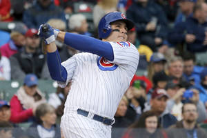 Photo - Chicago Cubs' Anthony Rizzo hits a home run off St. Louis Cardinals starting pitcher Adam Wainwright during the fifth inning of a baseball game on Friday, May 2, 2014, in Chicago. (AP Photo/Charles Rex Arbogast)