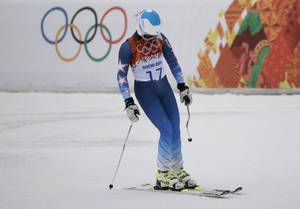 Photo - United States' Julia Mancuso reacts after skiing out of the first run of the women's giant slalom at the Sochi 2014 Winter Olympics, Tuesday, Feb. 18, 2014, in Krasnaya Polyana, Russia. (AP Photo/Gero Breloer)