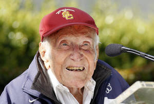 Photo - FILE - In a Friday May 9, 2014 file photo, Louis Zamperini gestures during a news conference, in Pasadena, Calif. Zamperini, a U.S. Olympic distance runner and World War II veteran who survived 47 days on a raft in the Pacific after his bomber crashed, then endured two years in Japanese prison camps, died Wednesday, July 2, 2014, according to Universal Pictures studio spokesman Michael Moses. He was 97. (AP Photo/Nick Ut, File)
