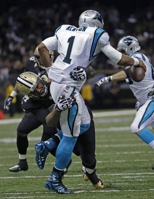 Photo - Carolina Panthers quarterback Cam Newton (1) is sacked by New Orleans Saints defensive end Cameron Jordan (94) in the first half of an NFL football game in New Orleans, Sunday, Dec. 8, 2013. (AP Photo/Dave Martin)
