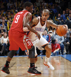 Photo - Oklahoma City's Eric Maynor (6) dribbles as Jonny Flynn (9) of Houston defends in the second half during the NBA basketball game between the Oklahoma City Thunder and the Houston Rockets at Chesapeake Energy Arena in Oklahoma City, Friday, Jan. 6, 2012. The Thunder won, 109-94. Photo by Nate Billings, The Oklahoman