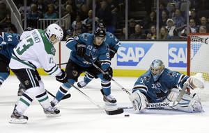 Photo - San Jose Sharks goalie Alex Stalock (32), right, stops a shot attempt from Dallas Stars left wing Ray Whitney during the second period of an NHL hockey game on Saturday, Dec. 21, 2013, in San Jose, Calif. (AP Photo/Marcio Jose Sanchez)