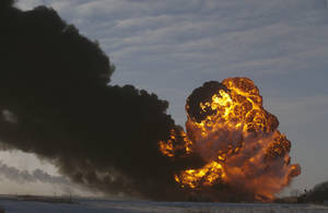 Photo - A fireball goes up at the site of an oil train derailment Monday, Dec 30, 2013, in Casselton, N.D. The train carrying crude oil derailed near Casselton Monday afternoon. Several explosions were reported as some cars on the mile-long train caught fire. (AP Photo/Bruce Crummy)