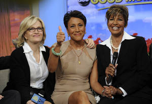 "Photo -   This image released by ABC shows host Robin Roberts, center, with her sister Sally-Ann Roberts, right and ABC News' Diane Sawyer on ""Good Morning America"" Monday, June 11, 2012, after Robin Roberts announced she has been diagnosed with myelodysplastic syndrome, a blood and bone marrow disease once known as preleukemia. She says she will undergo chemo and a bone marrow transplant this year as ""pretreatment"" for the disease, which she says she has known about for several weeks. She says her sister is a great match for her. While she says she'll miss a day here and there, she'll remain on the air. (AP Photo/ABC, Ida Mae Astute)"