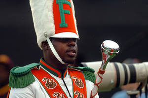 photo -   FILE - In this Saturday, Nov. 19, 2011 file photo, Robert Champion, a drum major in Florida A&M University's Marching 100 band, performs during halftime of a football game in Orlando, Fla. At least five people will face criminal charges in the hazing death Champion aboard a band bus in Orlando last fall, authorities said Tuesday, May 1, 2012. (AP Photo/The Tampa Tribune, Joseph Brown III, File) SST. PETERSBURG OUT; LAKELAND OUT; BRADENTON OUT; MAGS OUT; LOCAL TV OUT; WTSP CH 10 OUT; WFTS CH 28 OUT; WTVT CH 13 OUT; BAYNEWS 9 OUT
