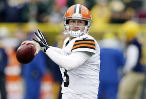 Photo - FILE - In this Oct. 20, 2013, file photo, Cleveland Browns' Brandon Weeden warms up before an NFL football game against the Green Bay Packers in Green Bay, Wis. Browns have released quarterback Weeden. (AP Photo/Tom Lynn, File)