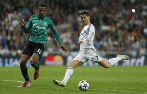 Photo - Real's Cristiano Ronaldo, right, in action with Schalke's Joel Matip during a Champions League round of 16 second leg soccer match between Real Madrid and FC Schalke 04 at the Santiago Bernabeu stadium in Madrid, Tuesday, March 18, 2014. (AP Photo/Andres Kudacki)