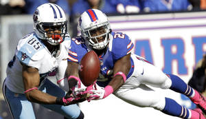 Photo -   Buffalo Bills cornerback Aaron Williams (23) breaks up a pass intended for Tennessee Titans wide receiver Nate Washington (85) during the second half of an NFL football game in Orchard Park, N.Y., Sunday, Oct. 21, 2012. (AP Photo/Gary Wiepert)