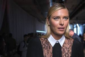 Photo - Tennis star Maria Sharapova stands on the runway before watching a presentation of the Jason Wu Spring/Summer 2014 collection during New York Fashion Week, September 6, 2013. REUTERS/Lucas Jackson (UNITED STATES - Tags: FASHION SPORT TENNIS) :rel:d:bm:GF2E9961HEL01