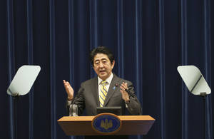 Photo - Japanese Prime Minister Shinzo Abe speaks during a press conference at his official residence in Tokyo, Tuesday, June 24, 2014. Abe formally announced an outline of his long-awaited growth strategy, a slew of reforms meant to revitalize the economy and restore its global competitiveness. The plan, approved by the Cabinet earlier in the day, includes dozens of proposed changes to labor regulations, government pension fund investments, corporate governance and tax policies that Abe says are needed to spur corporate investment and innovation. (AP Photo/Koji Sasahara)
