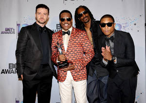 Photo - From left, Justin Timberlake, Charlie Wilson, Snoop Lion, and Pharrell Williams pose backstage at the BET Awards at the Nokia Theatre on Sunday, June 30, 2013, in Los Angeles. (Photo by Scott Kirkland/Invision/AP)