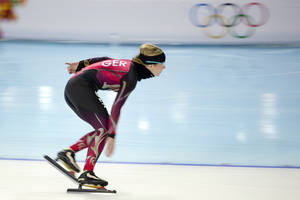 Photo - Speedskater Claudia Pechstein of Germany trains at the Adler Arena Skating Center during the 2014 Winter Olympics in Sochi, Russia, Thursday, Feb. 6, 2014. (AP Photo/Peter Dejong)