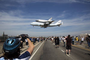 photo -   In this photo provided by NASA, the Space Shuttle Endeavour atop a modified 747 lands at Los Angeles International Airport on Friday, Sept. 21, 2012 in Los Angeles. Endeavour will be permanently displayed at the California Science Center in Los Angeles. (AP Photo/NASA, Matt Hedges)