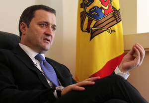 photo - FILE - In this March 27, 2012 file photo, Moldova&#039;s Prime Minister Vlad Filat speaks during an interview with The Associated Press at the Moldovan embassy in Brussels, Belgium. Moldovas pro-European government collapsed Tuesday, March 5, 2013, after it was defeated in a confidence vote likely leading to new elections. The vote raises questions whether the former Soviet republic will move away from the European Union and seek closer relations with Moscow. (AP Photo/Yves Logghe, File)