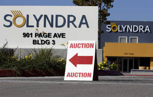 "Photo -   FILE - This Monday, Oct. 31, 2011 file photo shows an auction sign at the bankrupt Solyndra headquarters in Fremont, Calif. before an auction. The bankrupt solar company Solyndra has become a rallying point for conservatives who hold up the California firm as a symbol of the Obama administration's failed economic policies. Now hundreds of glass rods custom made for Solyndra solar panels have found new life as an art installation at the University of California, Berkeley. But like all things associated with Solyndra, the ""SOL Grotto"" exhibit has become a political target this election season. (AP Photo/Paul Sakuma, File)"