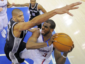 Photo -   Los Angeles Clippers guard Chris Paul, right, puts up a shot as San Antonio Spurs center Tim Duncan defends during the second half in Game 4 of an NBA basketball playoffs Western Conference semifinal, Sunday, May 20, 2012, in Los Angeles. The Spurs won 102-99. (AP Photo/Mark J. Terrill)