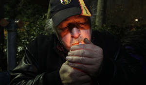 photo - Mike Momany smokes marijuana, Thursday, Dec. 6, 2012, just after midnight at the Space Needle in Seattle. Possession of marijuana became legal in Washington state at midnight, and several hundred people gathered at the Space Needle to smoke and celebrate the occasion, even though the new law does prohibit public use of marijuana. (AP Photo/Ted S. Warren)